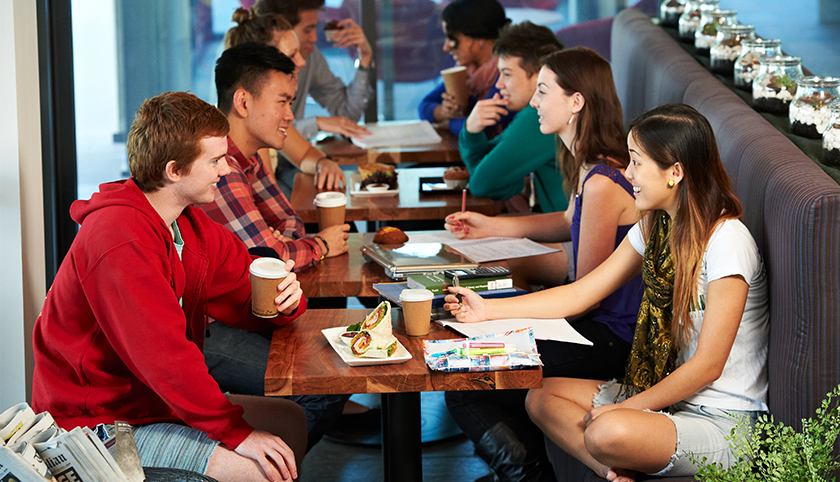 Group of students sitting in UCafe having coffee