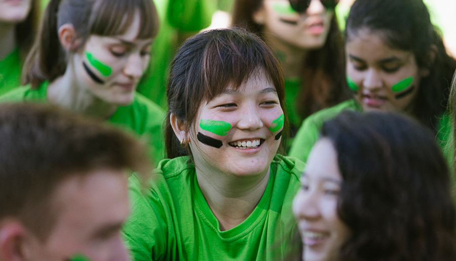 UniHallers in their green fresher shirts and face paint at the festival