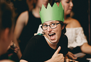 UniHaller wearing a party hat at an event