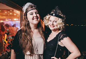 Two UniHallers dressed up in gatsby costumes on the rivercruise