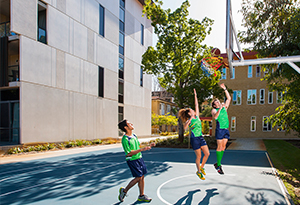 Residents playing basketball at the UniHall court
