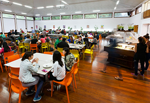 The Dining Hall filled with residents at tables enjoying their meal