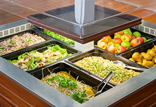 A variety of fresh ready made salads and fruit at the salad bar