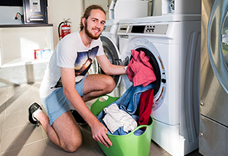 Male resident in shared laundry